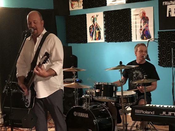 Guitarist John Ohly and drummer Steve Snyder rehearse in Rockville.