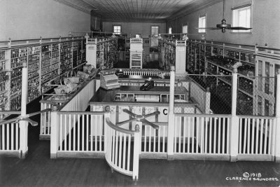 A 1918 photo by Piggly Wiggly founder Clarence Saunders shows the interior of one of the company's first self-service grocery stores. The former Takoma Park storefront now houses Historic Takoma.