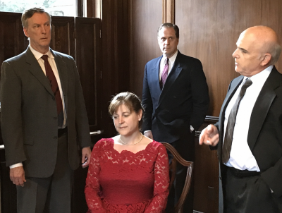 Inspector Hubbard (Mark Shullenbarger) questions Margot Wendice (Tracy Husted), while her husband Tony (Ted Culler) and her lover Max (Mark Steimer) look on.