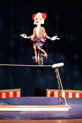 Abner, originally created by Len and Pat Piper, rides his unicycle.