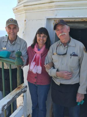 Artist/lighthouse historian Candace Clifford with volunteer keepers Bill Anderson and Mike Warren at Point Reyes Lighthouse.
