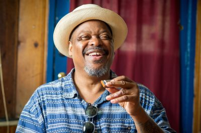 A portrait of the NEA National Heritage Fellowship artist: harmonica player and blues legend Phil Wiggins.