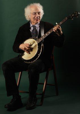 Grammy Award-nominated musician Stephen Wade plays banjo and guitar.