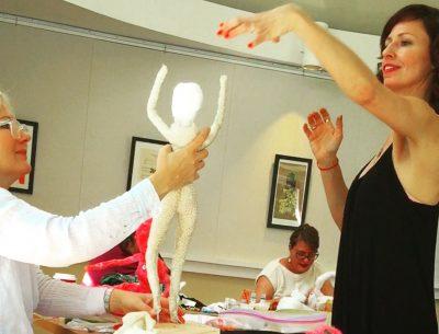 Artist Melissa Ichiuji guides workshop participants in creating soft sculptures.