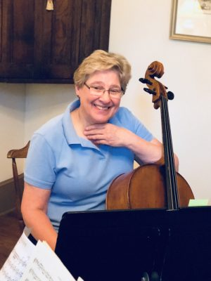 Lori Barnet plays cello for the Chamber Players and is principal cellist for the National Philharmonic.