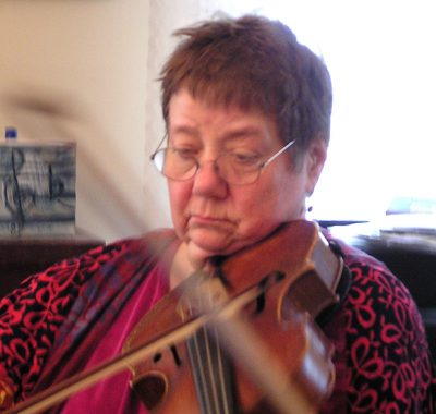 Betty Hauck overcame her hearing loss and resumed a modified musical career.