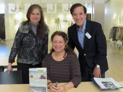 Drs. Ellen and Stuart Lessans pose with novelist Elizabeth Poliner at last year's book fair.