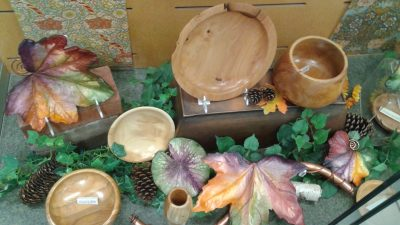 Wooden bowls made from Brookside gardens wood. Turned by local artist Jim Oliver. And Botanical resin leaves made by John Wayne Jackson.