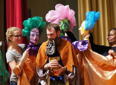 "Three Ladies (Bunraku puppets) and the bird catcher Papageno (Joseph Baker) in Bel Cantanti's production of ""The Magic Flute."""