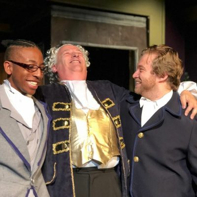 "From left, Dick Wilkins (Shomari Fortson), Mr. Fezziwig (Peter Wolff) and Young Ebenezer (Kyle Sprankle) in ""A Christmas Carol."""