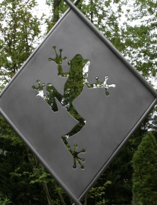 A sample panel depicting a tree frog. Each of the 40 panels will have a different plant or animal silhouette.