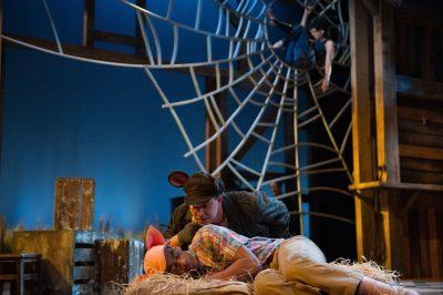 Templeton the Rat (Jonathan Feuer) tries to wake Wilbur (Timotheus German).