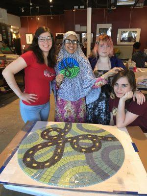 Maya, Atiqa, Maddie and Anne Marie with Atiqa's MCDOT medallion