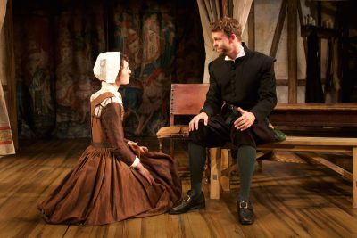"""Shakespearean love: Katie Kleiger (Alice Heminges) and Brandon McCoy (Isaac Jaggard) get flirty in Round House Theatre's production of """"The Book of Will."""""""