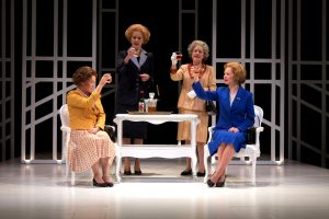 Chin-chin: Beth Hylton (older Queen Elizabeth), Kate Fahy (older Margaret Thatcher), Jennifer Mendenhall (young Queen Elizabeth) and Susan Lynskey (young Margaret Thatcher) raise a glass.