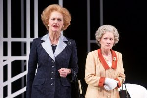 "Kate Fahy (older Margaret Thatcher) and Jennifer Mendenhall (young Queen Elizabeth) square off in ""Handbagged"" at Round House Theatre."