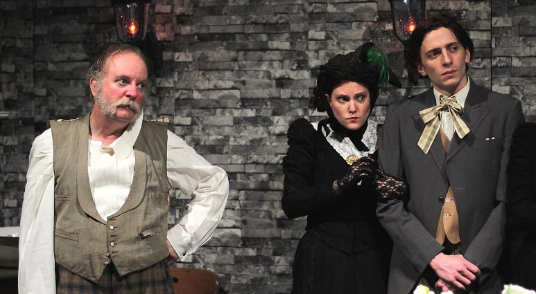 "Andy White (Hobson), Meredith Richard (Vickey, his daughter), and Logan Beverage (Freddy, Vickey's suitor) in Quotidian Theatre Company's production of ""Hobson's Choice."""