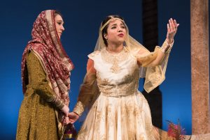 Princess Razia (Anjna Swaminathan) begs her caretaker (Emily Madden) to let her travel beyond the palace walls.