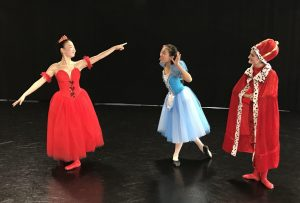 Jennifer Bivin as Queen of Hearts, Victoria Chai as Alice and Katie Grow as King