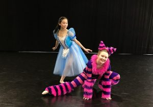 Victoria Chai as Alice and Genevieve Pelletier as Cheshire Cat