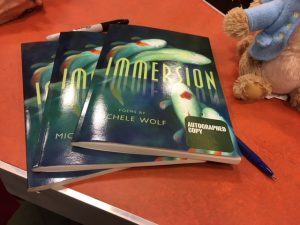 "Autographed copies of Michele Wolf's book, ""Immersion."""