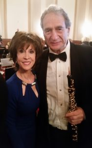Oboist H. David Meyers poses with singer Deana Martin after a performance for Congress.