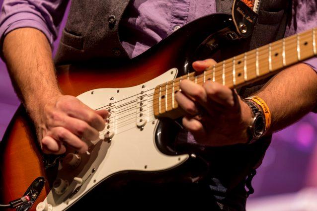 Shaun Hague playing guitar.