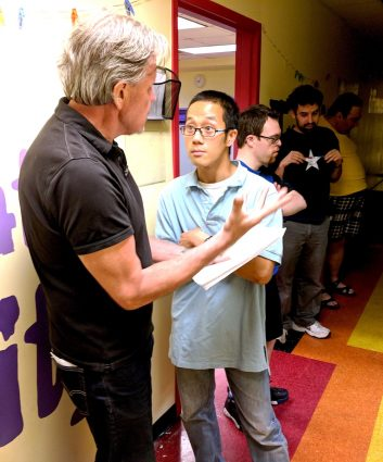 Ian Bannon discusses the next number with Vu Tran outside an ArtStream Cabaret rehearsal.