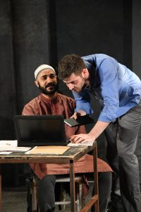 "Maboud Ebrahimzadeh and Thomas Keegan as Bashir and Nick Bright in Ayad Akhtar's ""The Invisible Hand"" at Olney Theatre Center."