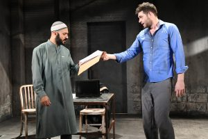 "Maboud Ebrahimzadeh and Thomas Keegan as Bashir and Nick Bright in ""The Invisible Hand"" by Ayad Akhtar."