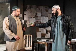 "Ahmad Kamal and Maboud Ebrahimzadeh as Dar and Bashir in Ayad Akhtar's ""The Invisible Hand"" at Olney Theatre Center."