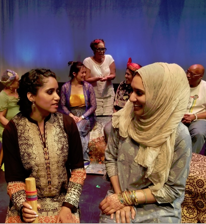 Foreground, from left, Fatima Toor and Taiba Zahir, both from Pakistan.