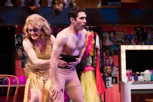 It's a cinch: Miss Tracy Mills (Rick Hammerly) helps Casey (Zack Powell) slip into drag.