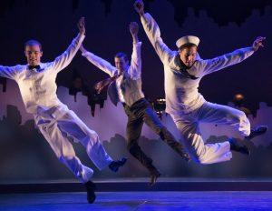 Flying high: Robert Mintz (Ensemble), Lance E. Hayes (Ensemble) and Rhett Guter (Gabey) show off their dancing skills.
