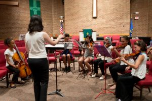 Montgomery Philharmonic Concertmaster Lydia Leong leads the Youth Chamber Music Festival's string ensemble.