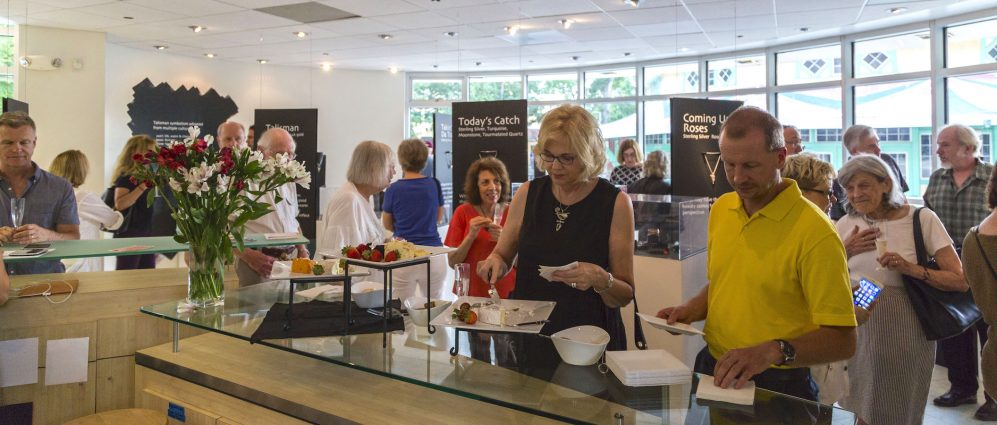 Guests enjoy the opening reception for the Silver Linings exhibit on July 6. The exhibit features the 2018 collection by Blair Anderson, work by Louis Kutyla and works by 14 faculty and students of SilverWorks.