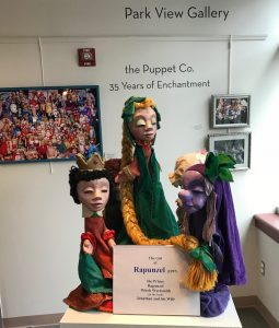 "On view in the Park View Gallery is the Puppet Co. cast of ""Rapunzel"" (1997): the Prince, Rapunzel and Witch Wartsmith. Jonathan and his Wife are hidden behind them."