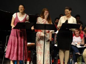 "From, left, Marianna Martindale, Rebecca Henry and Hillary LaBonte sing a selection from Gilbert and Sullivan's ""The Mikado"" at the 2013 Sing-Out."