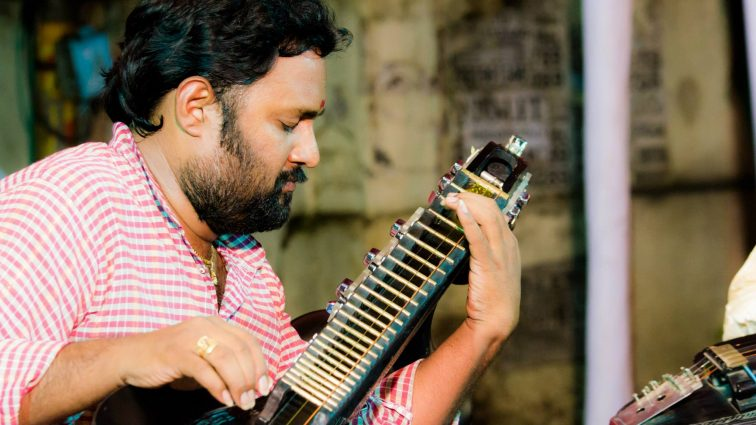 Phani Narayana Vadali plays the veena, a traditional plucked string instrument from southern India that creates a mellow tonal quality that sounds like the human voice.