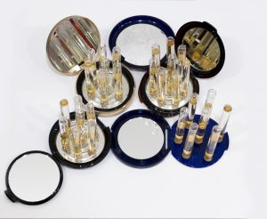 "In ""Divine Feminine,"" Nicole Salimbene carefully arranged makeup, mirrored compacts collected from friends and test tubes filled with water on a tray."