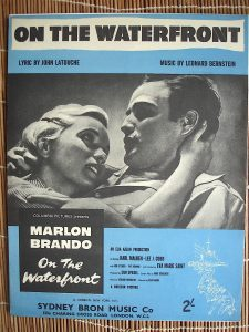 "A movie poster for ""On the Waterfront,"" part of an exhibit of memorabilia from the 1954 film that will be on display outside the concert hall."