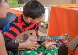 Children created and played instruments at a past KIDfest.