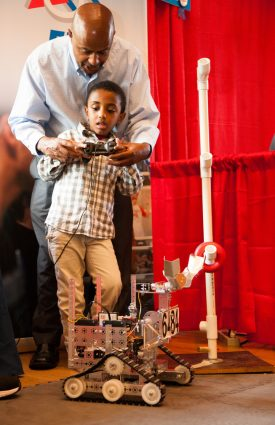 Tsichenis Berenbeh and his son drive FIRSTrobot at a past KIDfest.