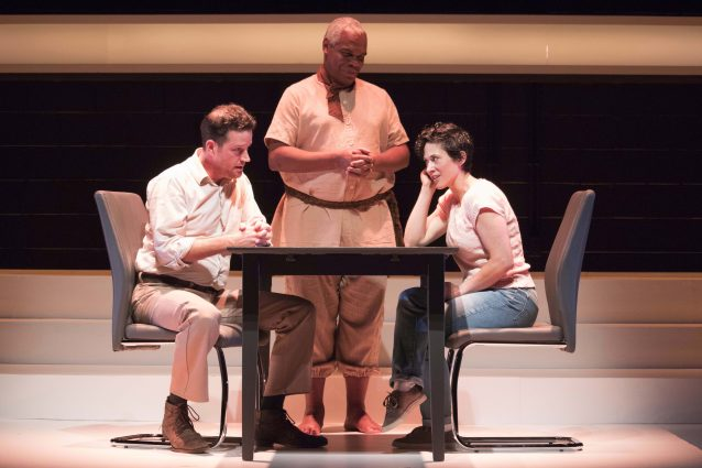 Uncle Peck (Peter O'Connor) and Li'l Bit (Alyssa Wilmoth Keegan) at dinner, waited on by Male Greek Chorus (Craig Wallace).
