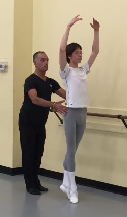 Olivier Munoz works with Maryland Youth Ballet student Sol Addison.