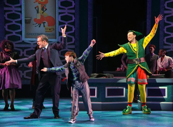"Bobby Smith as Walter Hobbs, Tyler Quentin Smallwood as Michael Hobbs and David Schlumpf as Buddy the Elf in ""Elf the Musical"" at Olney Theatre Center."