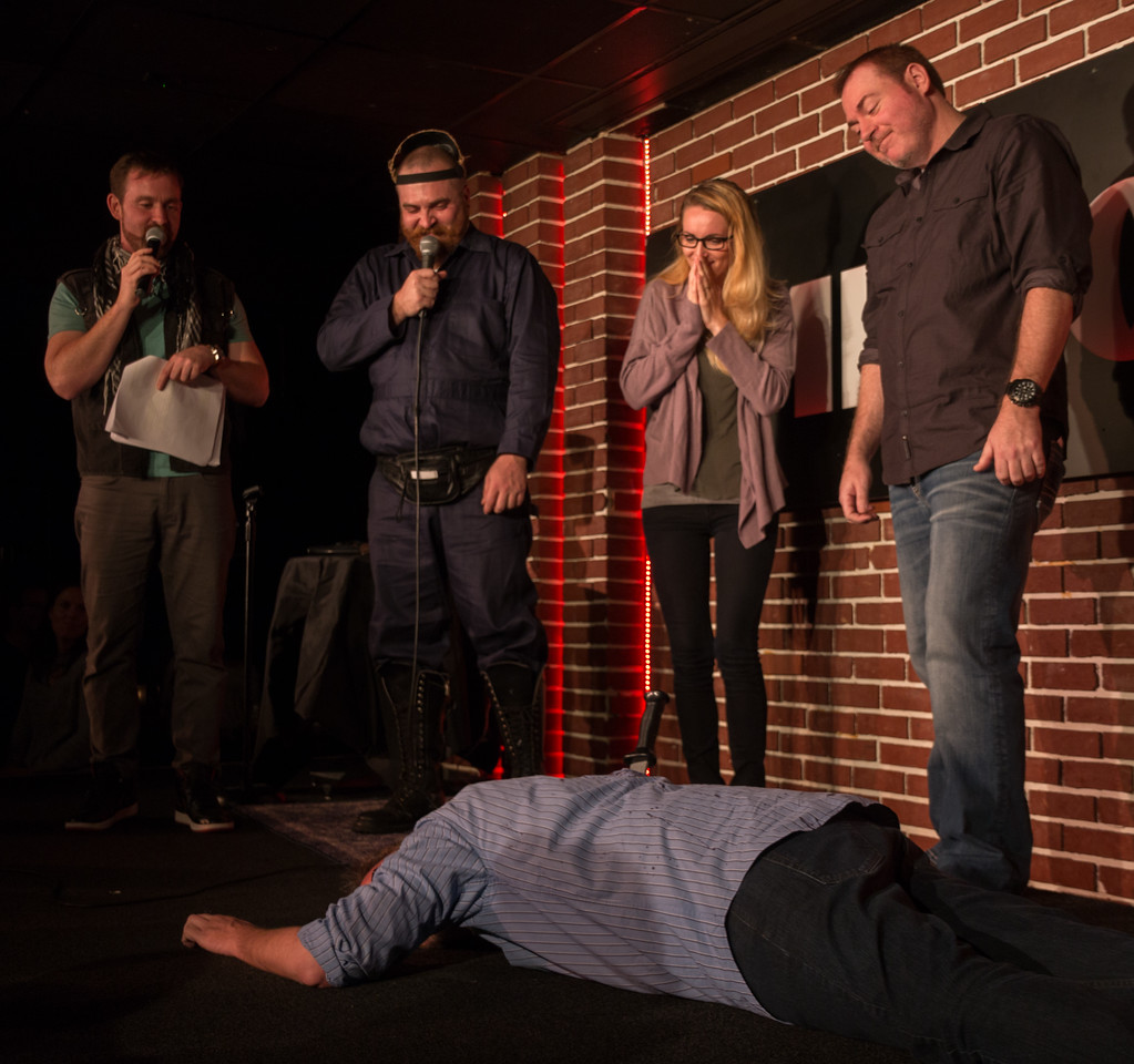 As one of the Die Laughing comedy murder mysteries unfolds, Joe Robinson plays the corpse as, from left, Justin Schlegel, Tommy Sinbazo, Kim Ambrose and Rob Maher look on.