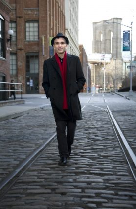 New York City-based violinist Gil Shaham strides down a Manhattan street.