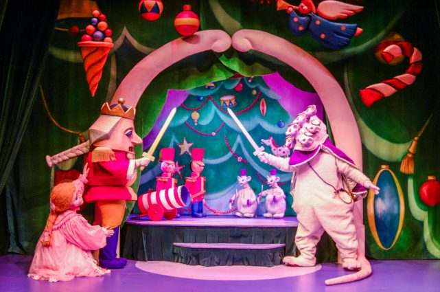 "The Nutcracker and his troops protect Clara-Marie from the Mouse King and his minions in The Puppet Co. Playhouse's ""The Nutcracker."""
