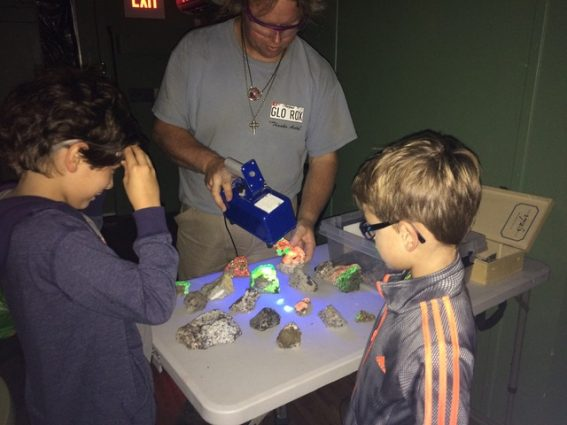 In the fluorescent room, the Gem, Lapidary and Mineral Society of Montgomery County will make rocks glow under long-wave and short-wave light.